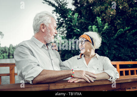 Happy elderly couple lovingly looking at each other - Stock Photo