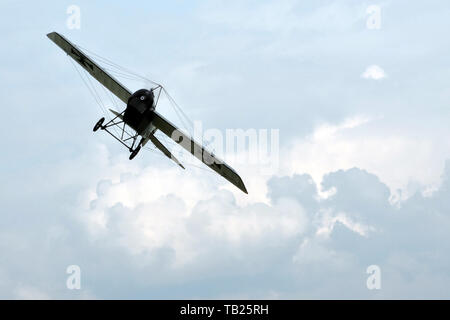 Mlada Boleslav, Czech Republic. 29th May, 2019. Historical airplane flying towards the camera as a silhouette. Blue sky with dramatic clouds in the background. Credit: Slavek Ruta/ZUMA Wire/Alamy Live News - Stock Photo
