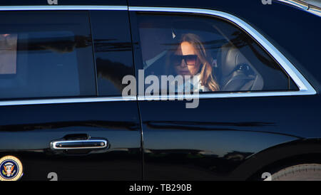 U.S. President Donald Trump, First Lady Melania and U.S. Ambassador to Japan William Hagerty aboard a presidential Cadillac One 'The Beast' leave from Tokyo International Airport in Tokyo, Japan on May 25, 2019. Credit: AFLO/Alamy Live News - Stock Photo