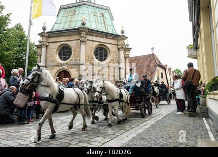 Telgte, Germany. 30th May, 2019. Carriage teams take part with a round trip within the 32nd carriage pilgrimage and pass the Chapel of Grace in the Old Town. Around 80 teams from Münsterland, Emsland and Sauerland took part in the annual Ascension Day event. Credit: Bernd Thissen/dpa/Alamy Live News - Stock Photo