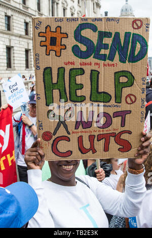 London, UK. 30 May, 2019. Campaigners from SEND National Crisis march from Downing Street to Parliament Square during a demonstration to demand improvements in the diagnosis and assessment of young people with SEND, assistance for their families, funding and legal and financial accountability for local authorities in their treatment of young people with SEND and their families. A petition was also presented at 10 Downing Street. Credit: Mark Kerrison/Alamy Live News - Stock Photo