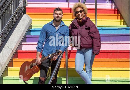 Singer-songwriter Emeli Sande with busking musician Finn Henderson Palmer during filming in her home city of Aberdeen for a new BBC Scotland series 'Emeli Sande's Street Symphony'. - Stock Photo