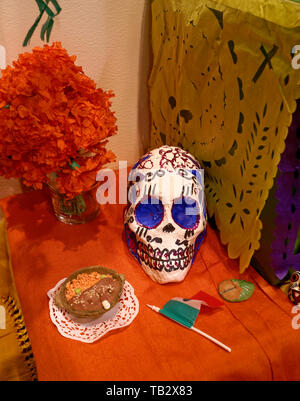 Closeup of decorations and offerings on a Mexican Day of the Dead altar - Stock Photo