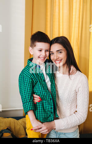 Mother hugging her little son . Tenderness, love, multinational family - Stock Photo