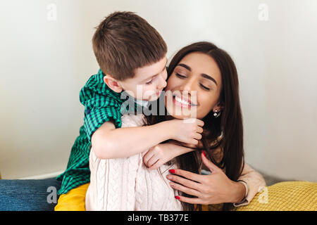 mother with son, happy family smiling and hugging at home. Multinational family - Stock Photo