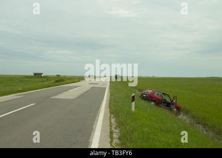 irresponsible driving in bad weather conditions, vehicle went off road in ditch, near Kikinda city - Stock Photo