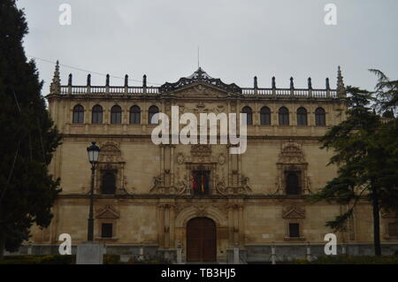 Main Facade Of The University On A Rainy Day In Alcala De Henares. January 1, 2014. Alcala De Henares, Madrid, Spain. Street Photography, History. - Stock Photo