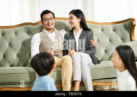 asian family with two children having a good time at home - Stock Photo
