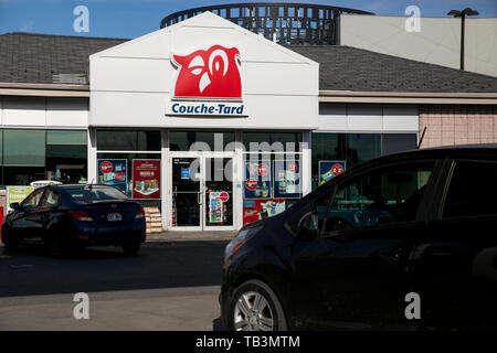Sign for a Couche-Tard convenience store in Montreal ...