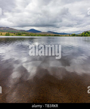 A panoramic view across Loch Rannoch, near the village Bridge of Ericht, looking west toward Rannoch Moor - Stock Photo