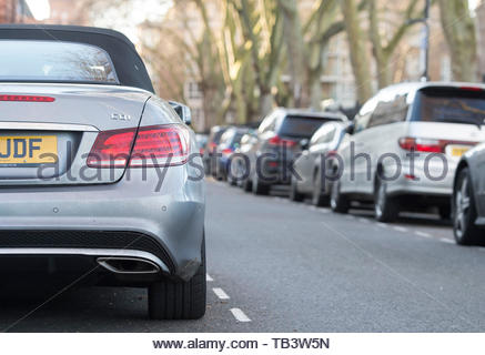 Embargoed until 0001 Thursday 30 May File photo dated 16/01/16 of cars parked on a residential street in London. National guidelines for sharing parking data will make it easier for drivers to find a space, the Department for Transport (DfT) has claimed. - Stock Photo