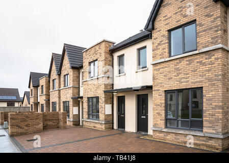 Houses for sale in a housing estate in Ireland on a rainy winter day - Stock Photo