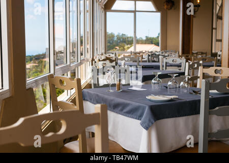 Camacha, Portugal, Madeira - August 1, 2018: The interior of the restaurant is waiting for visitors. - Stock Photo
