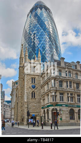 LONDON THE CITY ST MARY AXE THE CHURCH ST ANDREW UNDERSHAFT OVERSHADOWED BY THE GHERKIN SKYSCRAPER - Stock Photo