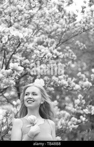 girl in beautiful magnolia flowers pink color tree - Stock Photo