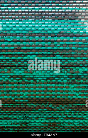 Looking at an old dirty metal grid from below - Stock Photo