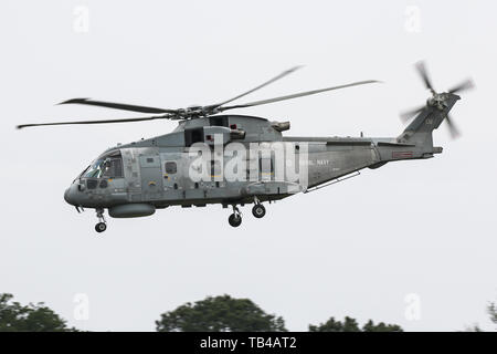 A Royal Navy AgustaWestland Merlin HM2 lands at Mont-de-Marsan Air Base during the NATO Tiger Meet 2019 exercise - Stock Photo