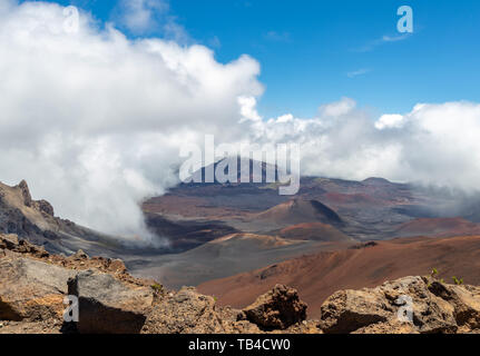 Clouds rolling over beautiful mountains with vivid colors at Haleakala National Park