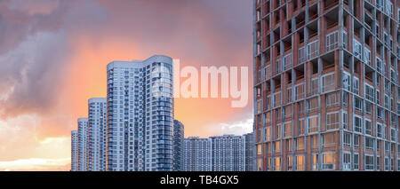 Modern condo buildings with huge windows. Modern new flat apartment real estate concept. Outdoor residential home facilities - Stock Photo