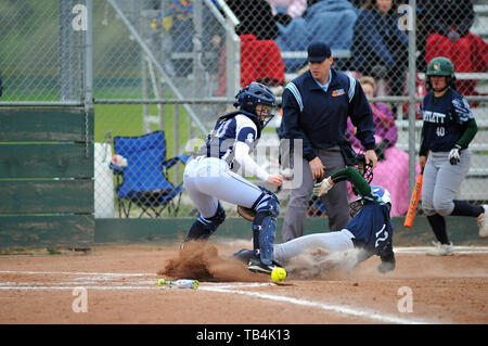 Runner slides in safely to the plate as throw from home was wild and eluded the catcher. USA. - Stock Photo