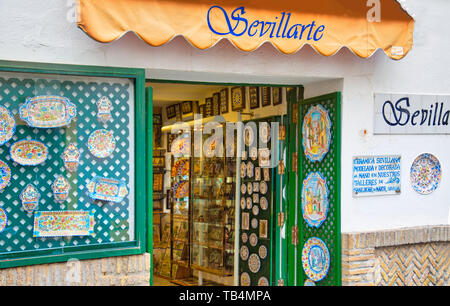 Seville, Spain-October 2, 2018: Seville streets at an early sunset in the scenic historic city center - Stock Photo