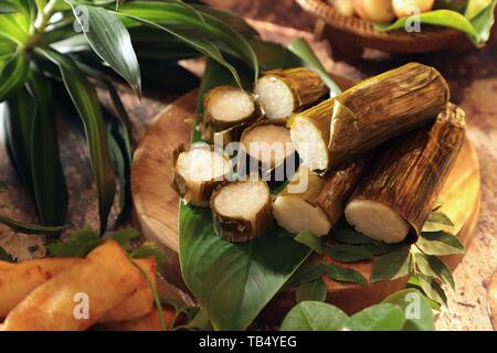 Lemang. Savoury glutinous rice cake from Minangkabau cuisine, West Sumatra - Stock Photo