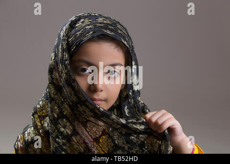 Young Muslim girl with black hijab - Stock Photo