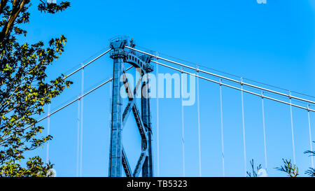 The top section of one of the riveted steel towers of the Lions Gate Bridge, or First Narrows Bridge, between Vancouver's Stanley Park and the municip - Stock Photo