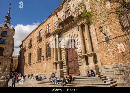 TOLEDO, SPAIN - April 26, 2019: People visiting the cathedral and City Hall of Toledo, Spain - Stock Photo