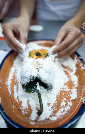 A cooking class taught by Chel Alonso Hernandez, participants learnt to make the traditional seasonal Chile En Nogada dish. Mesones Sacristia Puebla - Stock Photo