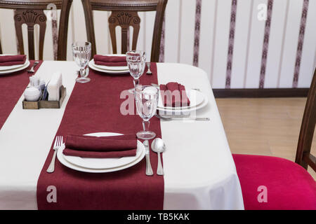 serving banquet table in a luxurious restaurant in red and white style - Stock Photo
