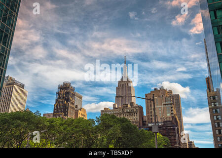 New York City. Empire State Building, Skyscrapers and Cloudy Blue Sky - Stock Photo
