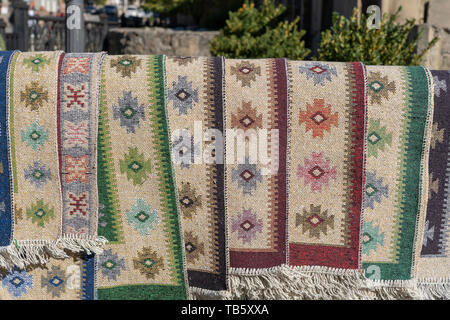 Traditional Georgian carpets and kilim rugs with typical geometrical patterns for sale, Tbilisi, Georgia, close up - Stock Photo