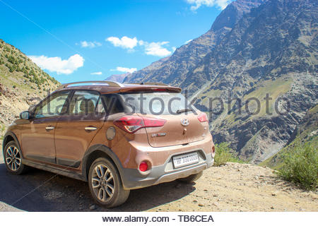 Manali, Himachal Pradesh, India- Dated: May 2, 2019: A Hyundai i20 car parked alongside a road in Manali with beautiful mountains in the background - Stock Photo