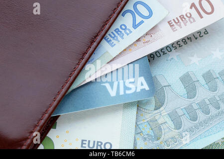 Moscow, Russia - May 2019: Passport,  credit card with Visa text and Euro banknotes. Image can be used for topics like business, finance, banking, tra - Stock Photo