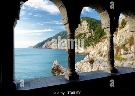 Columns of famous gothic Church of St. Peter (Chiesa di San Pietro) with beautiful shoreline scenery in Porto Venere village on the Ligurian coast of  - Stock Photo