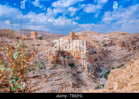 Mar Saba monastery on the wall of Kidron valley in Judean desert - Stock Photo