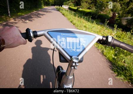 riding a rental bicycle, Ford-Pass-Bike, DB Call a Bike, Cologne, Germany.  Fahrt auf einem Mietfahrrad, Fordpass-Bike, DB Call a Bike, Koeln, Deutsch - Stock Photo