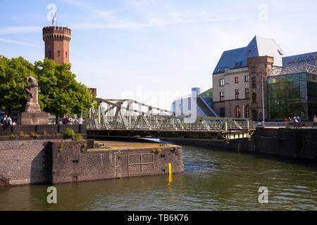 the open swing bridge at the Rheinau harbor, the Malakoff tower and the Chocolate Museum, Cologne, Germany.  die geoeffnete Drehbruecke am Rheinauhafe - Stock Photo