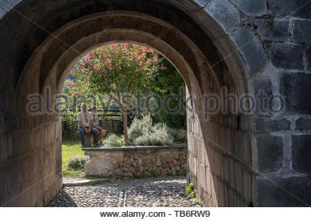 Tourists visiting the Cathédrale Sainte-Marie / Cathédrale Notre-Dame de Saint-Bertrand-de-Comminges cathedral, Haute-Garonne, Pyrenees, France - Stock Photo
