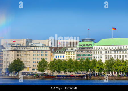 Hamburg, Germany beautiful view of Hamburg city center houses and Alster lake with fountain rainbow - Stock Photo
