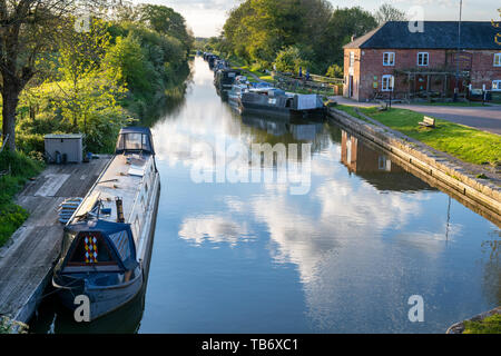 Canal boats on the Kennet and Avon Canal  at Pewsey Wharf in spring.  Pewsey, Wiltshire, England - Stock Photo