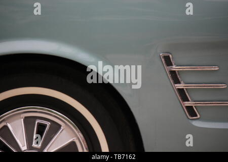 Mint green 1965 Ford Mustang front grill in mint condition. - Stock Photo