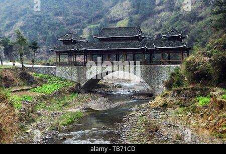 A traditionally built bridge in Xijiang village in Guizhou, China. - Stock Photo
