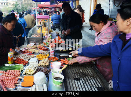 Grilled sausages stall in Guizhou, China - Stock Photo