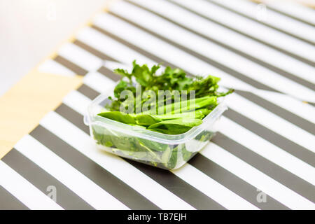 Herbs and spices on on the kitchen table. The food in the containers, a healthy diet, good nutrition concepts - Stock Photo