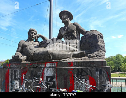 MUNICH, GERMANY - MAY 2, 2019 Sculpture group dated 1925 at the SW beginning of the Reichenback bridge over the Isar river in Munich - Stock Photo