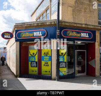 Swindon, United Kingdom - May 04 2019:   The entrance to William Hill Bookmakers on Temple Street - Stock Photo
