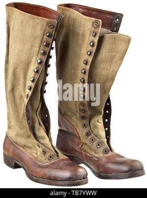 A pair of lace-up boots to the tropical uniform, Depot pieces. Soles and reinforcements in brown leather, brown canvas shafts with brown painted iron eyelets and hooks (filmed with rust), linen lining stamped with the size and the manufacturer's mark. Welted leather soles with wooden pegs. Slight signs of wear. historic, historical 20th century, Additional-Rights-Clearance-Info-Not-Available - Stock Photo