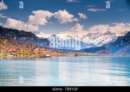 Brienz town on lake Brienz by Interlaken with the Swiss Alps covered by snow in the background, Switzerland, Europe - Stock Photo